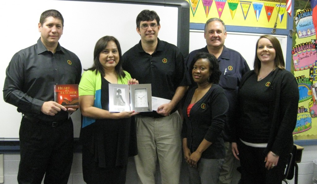 Credit union team members present Molly Savala with her Appreciated Teacher Award.