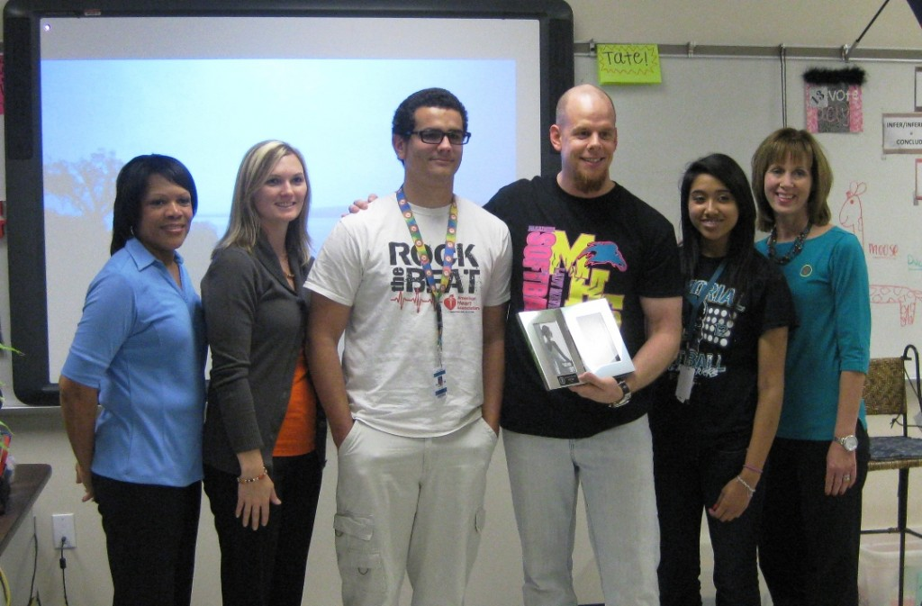 Credit union team members and Pasadena Memorial students with Paul Tate.