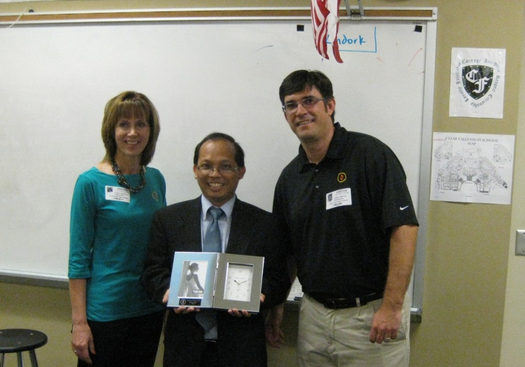 The Credit Union's CEO Linda Lukaszewski and Jamieson Mackay present Mr. Tran with the award.