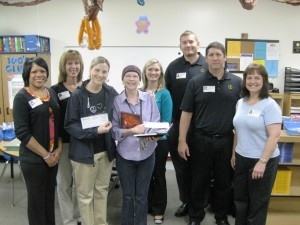 Credit union staff present Janet Wohlgemuth of MacArthur Elementary with her Appreciated Teacher Award.